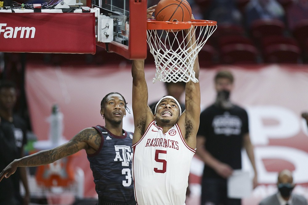 Former Arkansas guard Moses Moody, who was taken by the Golden State Warriors with the 14th overall pick, led the Razorbacks in scoring last season with an average of 16.8 points — third in the SEC and fourth best among NCAA freshmen. (NWA Democrat-Gazette/Charlie Kaijo)