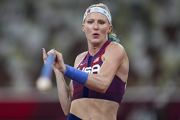 Sandi Morris, of the United States, competes in qualifications for the women's pole vault at the Summer Olympics, Monday, Aug. 2, 2021, in Tokyo.(AP Photo/Matthias Schrader)