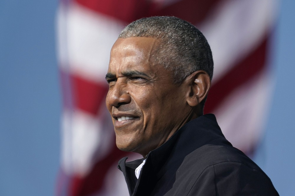 In this Nov. 2, 2020 file photo, former President Barack Obama speaks at a rally as he campaigns for Democratic presidential candidate former Vice President Joe Biden at Turner Field in Atlanta. Obama has scaled down his 60th birthday bash due to the surge in the delta variant of the coronavirus.  (AP Photo/Brynn Anderson)