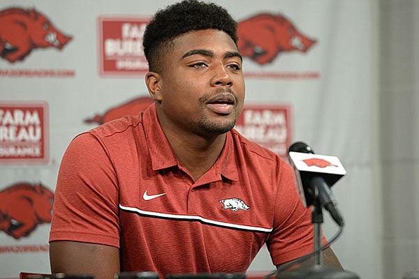 Arkansas receiver Treylon Burks speaks to reporters during a news conference Thursday, Aug. 5, 2021, in Fayetteville.