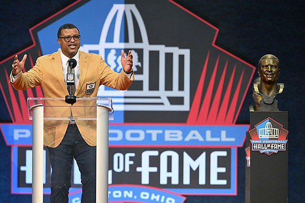 Steve Atwater, a member of the Pro Football Hall of Fame Centennial Class, speaks during the induction ceremony at the Pro Football Hall of Fame, Saturday, Aug. 7, 2021, in Canton, Ohio. (AP Photo/David Richard)