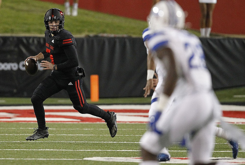 Layne Hatcher (left) was one of the nation's most efficient deep passers and cut his interceptions from 10 in 2019 to just 2 on 194 attempts last season. (Arkansas Democrat-Gazette/Thomas Metthe)