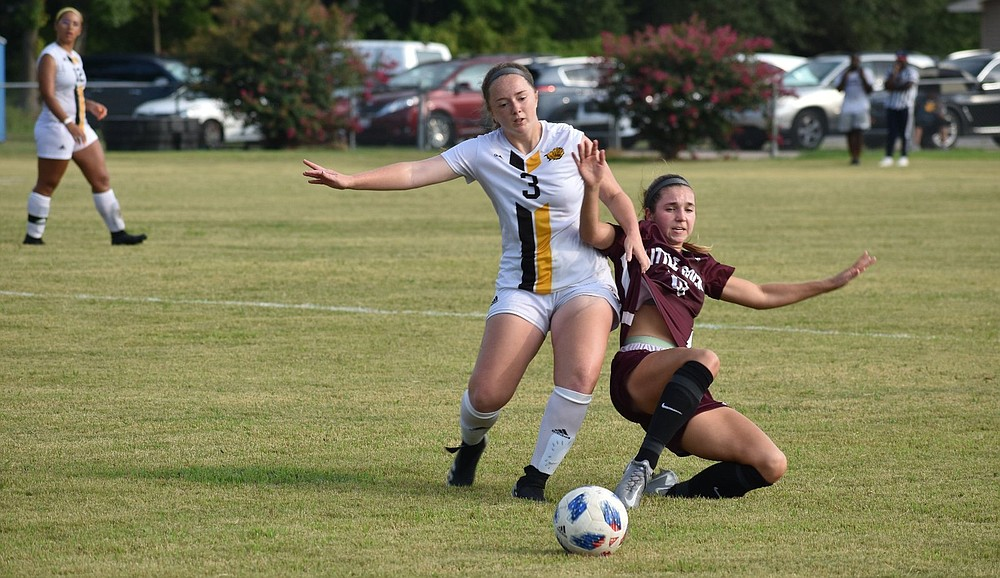 Lady lions midfielder Halley Wheeler and Trojans forward Jessie Vaden of UALR fight for the ball in the second half of the game Thursday at Pumphrey Field.  (Pine Bluff Commercial/I.C. Murrell)