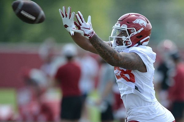 Arkansas tight end Koilan Jackson makes a catch Saturday, Aug. 7, 2021, during practice at the university practice facility in Fayetteville.