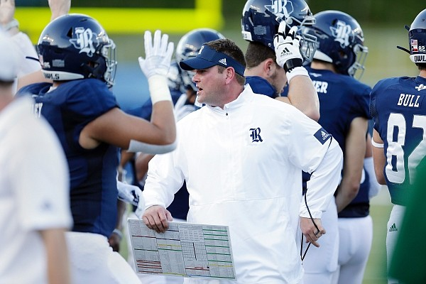 Rice coach Mike Bloomgren (center) during the first half of an NCAA college football game Saturday, Sept. 21, 2019, in Houston. (AP Photo/Michael Wyke)