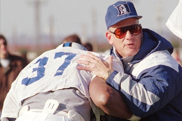 Fred Goldsmith of Duke works with Kentucky's Donte' Key and other lineman during practice Wednesday, Dec. 20, 1995 in Montgomery, Ala., in preparation for the Blue Gray All-Star Classic on Christmas Day. Goldsmith resurrected the Duke program in 1994 and decided to stay even though Miami and several other schools came calling. (AP Photo)