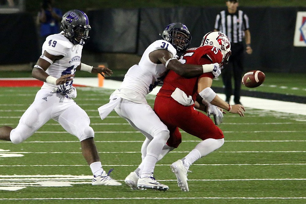 UCA linebacker George Odum forces a fumble by Arkansas State quarterback Justice Hansen during the Bears' 28-23 victory over the Red Wolves in 2016 in Jonesboro. That was the last time the Bears defeated the Red Wolves, but they'll get another chance to do so Saturday in the season opener for both teams. (Photo courtesy of the University of Central Arkansas)