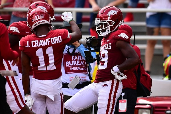 Arkansas receiver Tyson Morris celebrates after making a touchdown catch in Arkansas' season-opening victory over Rice on Sept. 4, 2021, in Fayetteville.