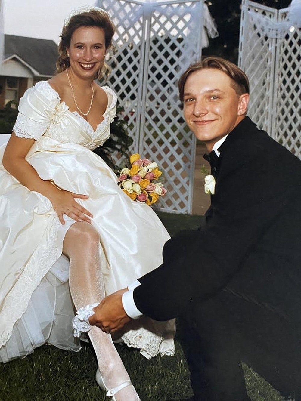 """Tim Carroll and Brandy Rennicke were married on June 29, 1996. Tim's muscles caught Brandy's attention, but his smarts and sense of humor captured her heart. """"Once I met him, I realized how dang smart he is,"""" she says. """"I just needed to sit down and get to know him."""" (Special to the Democrat-Gazette)"""