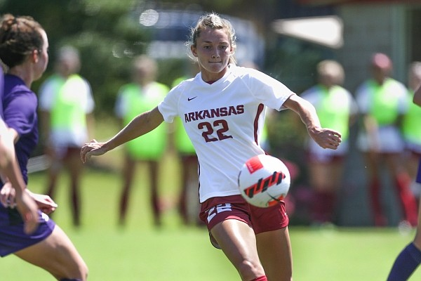 Arkansas forward Parker Goins (22) leads the ball, Monday, September 6, 2021 during a soccer game at Razorback Field in Fayetteville.