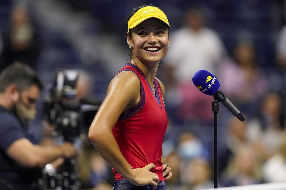 Emma Raducanu, of Great Britain, reacts after defeating Maria Sakkari, of Greece, during the semifinals of the US Open tennis championships, Thursday, Sept. 9, 2021, in New York. (AP Photo/Seth Wenig)