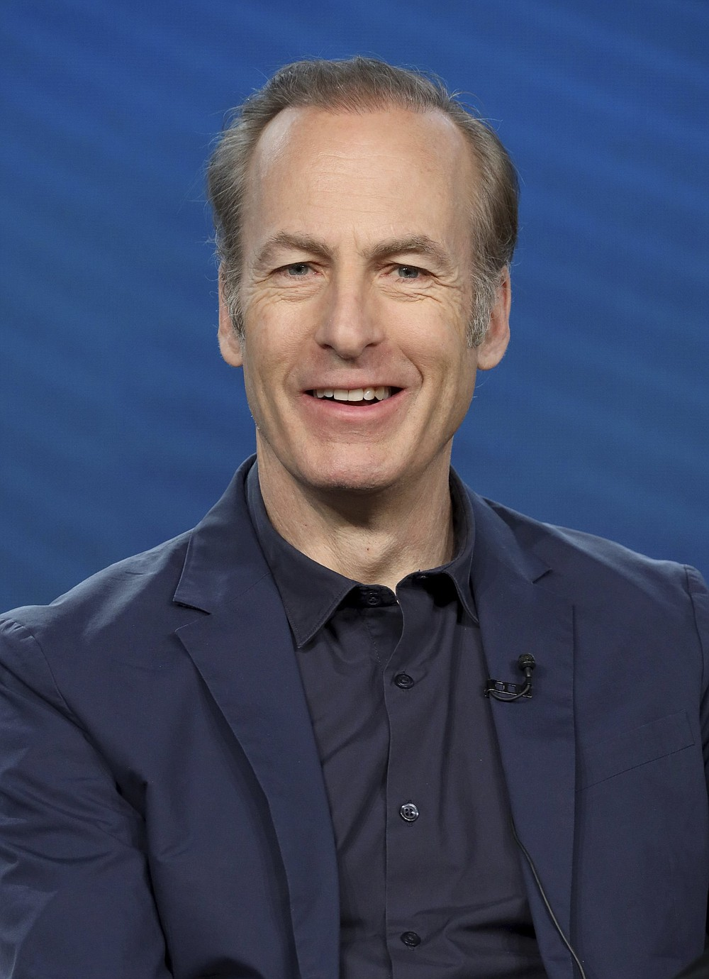 """Bob Odenkirk speaks at the AMC's """"Better Call Saul"""" panel during the AMC Networks TCA 2020 Winter Press Tour at the Langham Huntington on Thursday, Jan. 16, 2020, in Pasadena, Calif. (Photo by Willy Sanjuan/Invision/AP)"""
