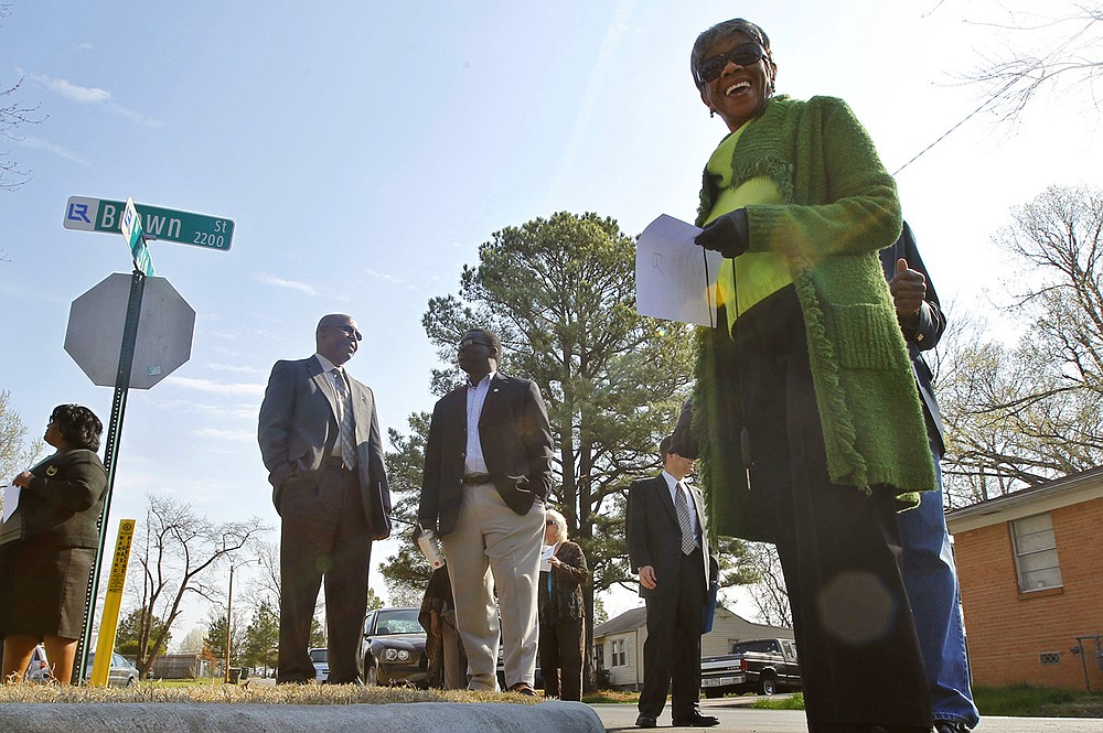 Little Rock Director Erma Hendrix (right), and other  local residents and community representatives gather around a newly rebuilt curb, gutter and sidewalk area along Brown and 32nd streets on March 3, 2011. Hendrix, who represented Ward 1 since 2007, died Wednesday at  the age of 91. She had also served on the city's Board in 1993-94. (Arkansas Democrat-Gazette/Benjamin Krain)