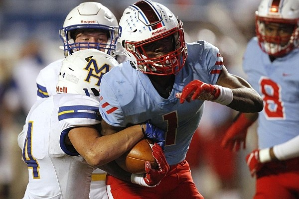 Little Rock Parkview running back James Jointer (1) fights  off Mountain Home linebacker Tatem Beshears (4) for a 14-yard touchdown run during the second quarter of the Patriots' 45-21 win on Friday, Nov. 6, 2020, at War Memorial Stadium in Little Rock.