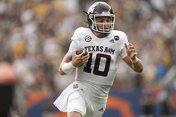 Texas A&M quarterback Zach Calzada runs for a short gain against Texas A&M in the second half of an NCAA college football game Saturday, Sept. 11, 2021, in Denver. Texas A&M won 10-7. (AP Photo/David Zalubowski)