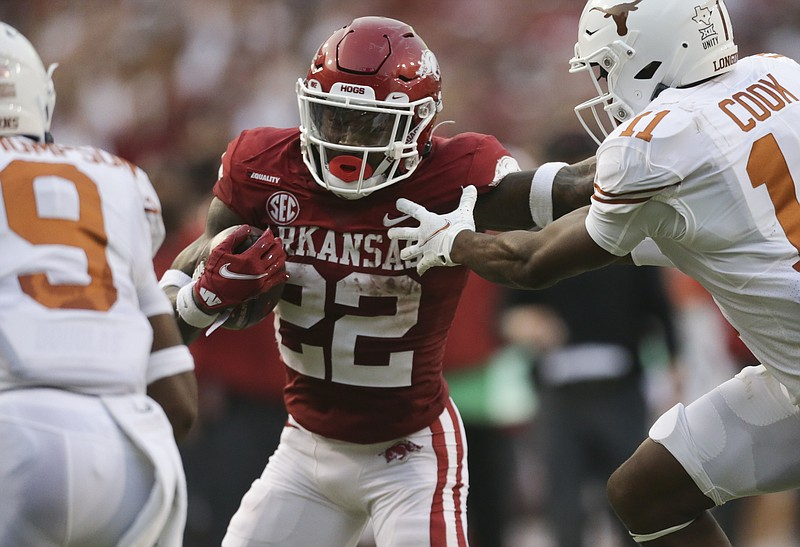 Arkansas running back Trelon Smith (22) carries the ball, Saturday, September 11, 2021 during the second quarter of a football game at Reynolds Razorback Stadium in Fayetteville. Check out nwaonline.com/210912Daily/ for today's photo gallery. .(NWA Democrat-Gazette/Charlie Kaijo)