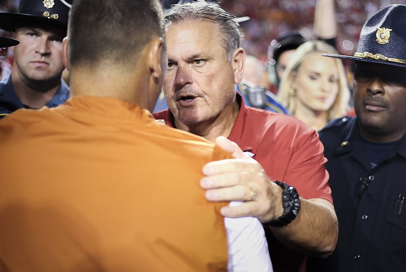 Arkansas head coach Sam Pittman shakes hands with Texas head coach Steve Sarkisian, Saturday, September 11, 2021 during a football game at Reynolds Razorback Stadium in Fayetteville. Check out nwaonline.com/210912Daily/ for today's photo gallery. .(NWA Democrat-Gazette/Charlie Kaijo)