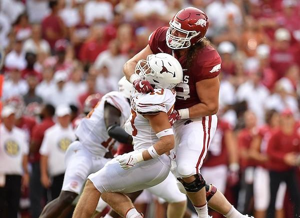 Arkansas offensive lineman Dalton Wagner (78) blocks Texas linebacker Marcus Tillman (13) during a game Saturday, Sept. 11, 2021, in Fayetteville.
