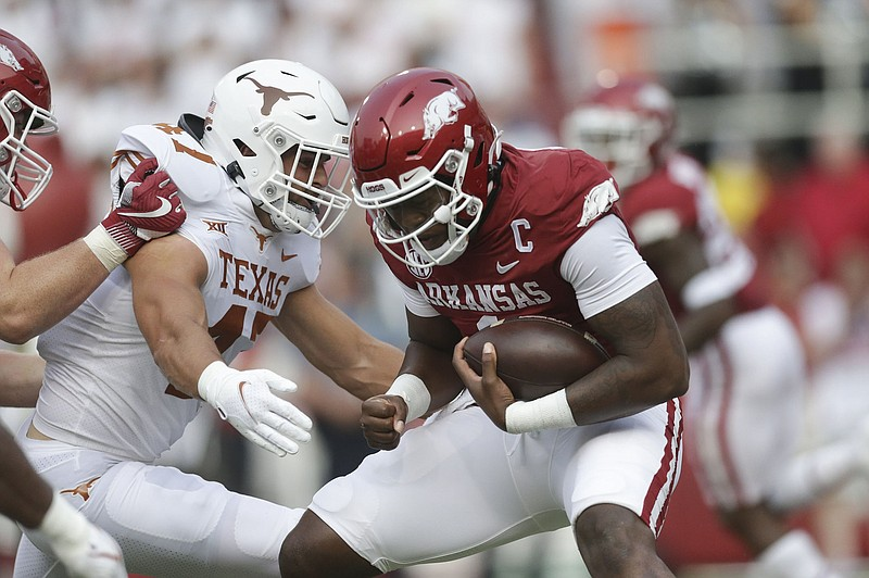 Arkansas quarterback KJ Jefferson (1) carries the ball, Saturday, September 11, 2021 during the first quarter of a football game at Reynolds Razorback Stadium in Fayetteville. Check out nwaonline.com/210912Daily/ for today's photo gallery. .(NWA Democrat-Gazette/Charlie Kaijo)