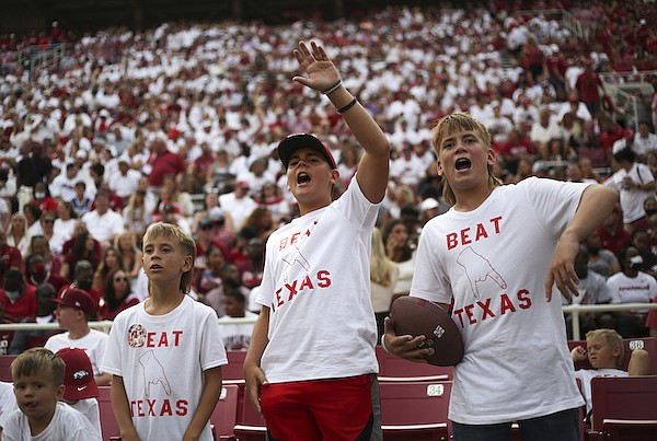 From left, Paton, Silas, Joshua and Caleb Everett of Greenbrier cheer during a game between Arkansas and Texas on Saturday, Sept. 11, 2021, in Fayetteville.