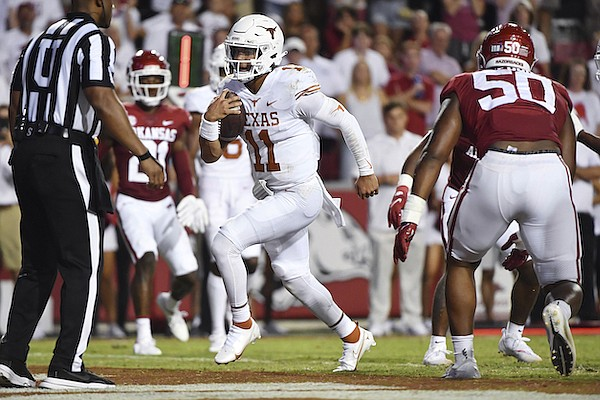Texas quarterback Casey Thompson (11) runs for a touchdown against Arkansas during the second half of an NCAA college football game Saturday, Sept. 11, 2021, in Fayetteville. (AP Photo/Michael Woods)