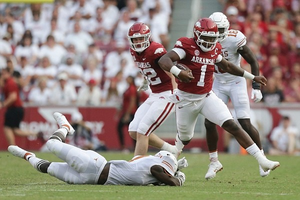 Arkansas quarterback KJ Jefferson (1) carries the ball, Saturday, September 11, 2021 during the first quarter of a football game at Reynolds Razorback Stadium in Fayetteville.