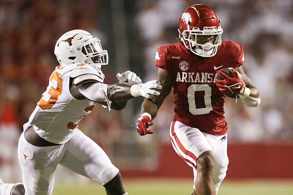Arkansas running back AJ Green (0) carries the ball, Saturday, September 11, 2021 during the fourth quarter of a football game at Reynolds Razorback Stadium in Fayetteville.