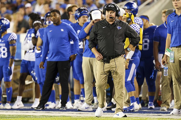 Kentucky head coach Mark Stoops watches the team from the sideline during the first half of an NCAA college football game against Missouri in Lexington, Ky., Saturday, Sept. 11, 2021. (AP Photo/Michael Clubb)