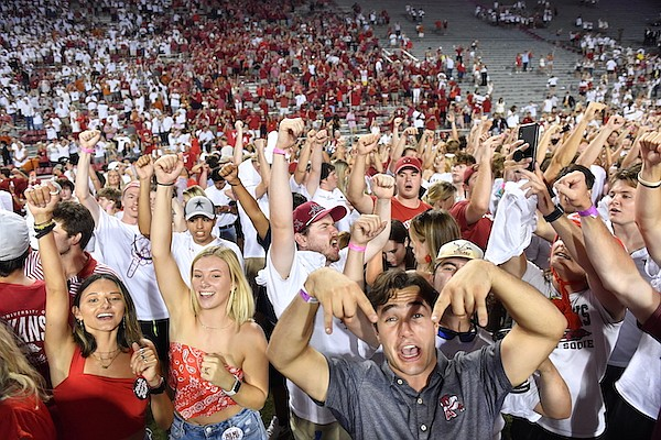 Arkansas fans celebrate the Razorbacks 40-21 win over Texas during an NCAA college football game Saturday, Sept. 11, 2021, in Fayetteville. (AP Photo/Michael Woods)
