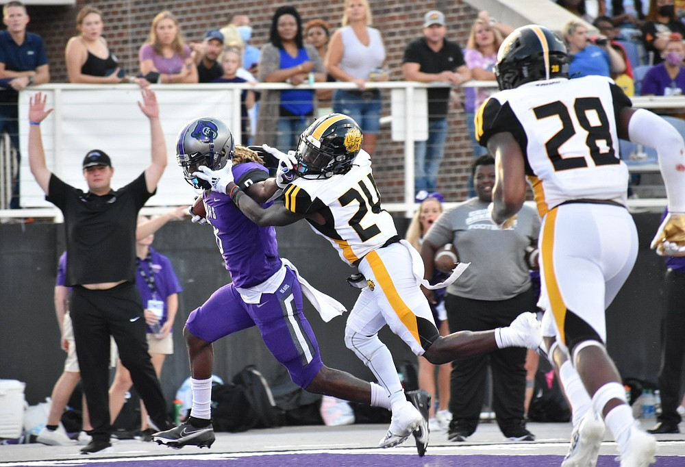 Central Arkansas wide receiver Tobias Enlow stiff-arms Arkansas-Pine Bluff defender Keyvien Johnson on his way to the end zone during the second quarter Saturday night at Estes Stadium in Conway. (Pine Bluff Commercial/I.C. Murrell)