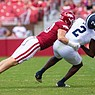 Arkansas linebacker Bumper Pool hits Georgia Southern running back Logan Wright during a game on Sept. 18, 2021 in Fayetteville.