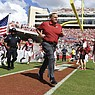 Arkansas coach Sam Pittman leads his team onto the field to play Georgia Southern during the first half of an NCAA college football game Saturday, Sept. 18, 2021, in Fayetteville. (AP Photo/Michael Woods)