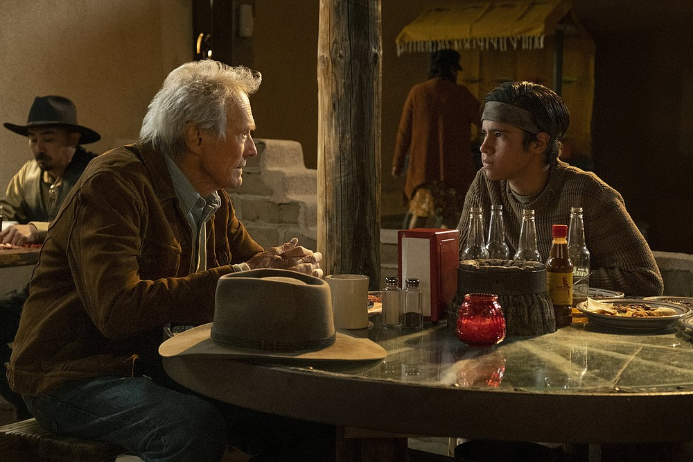 """Stoic knight errant Mike Milo (Clint Eastwood) travels to Mexico to rescue Rafo (Eduardo Minett), the beer-drinking, cockfighting,13-year-old son of his former employer in """"Cry Macho."""""""