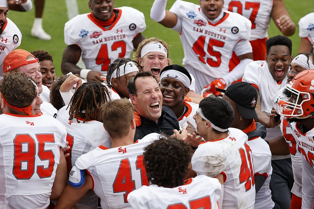 Coach K.C. Keller (center) led Sam Houston State to its first FCS national championship in May with a victory over South Dakota State. The Bearkats visit Central Arkansas in a FCS Top 25 matchup today at Estes Stadium in Conway. (AP/Michael Ainsworth)