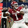 Arkansas quarterback KJ Jefferson throws a long pass for a touchdown in the first half of an NCAA college football game against Texas A&M in Arlington, Texas, Saturday, Sept. 25, 2021. (AP Photo/Tony Gutierrez)