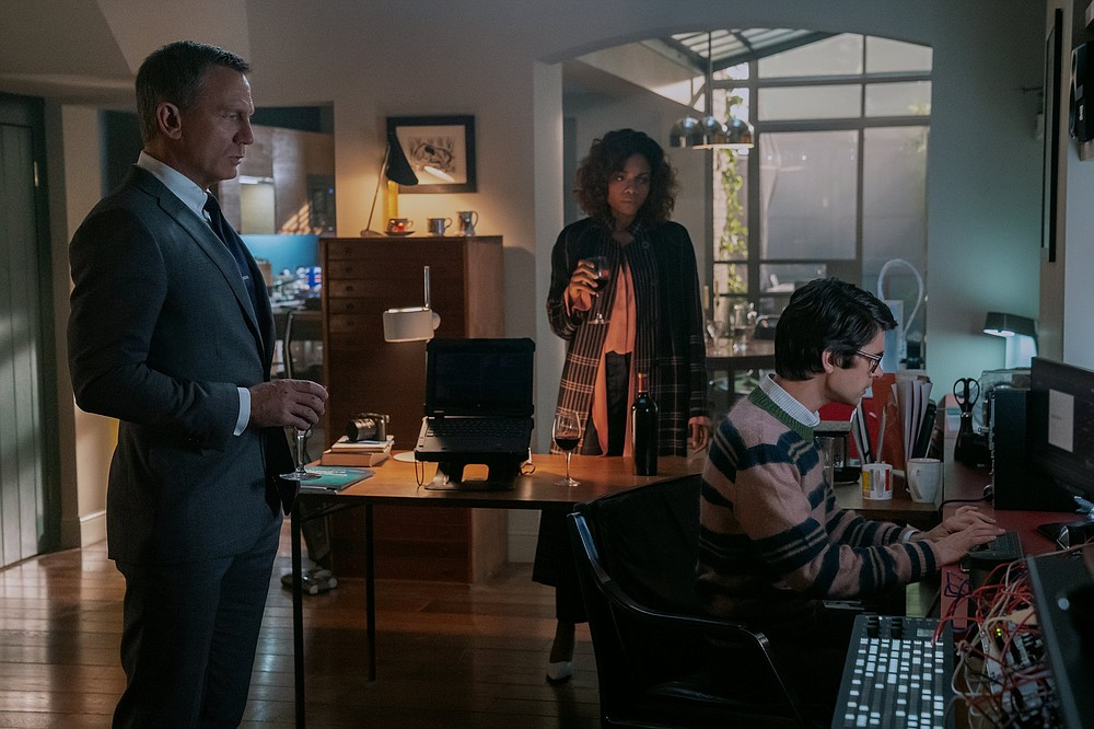 """Getting the band back together: James Bond (Daniel Craig), Moneypenny (Naomie Harris) and Q (Ben Whishaw) chop it up one last time in Cary Joji Fukunaga's """"No Time to Die."""""""