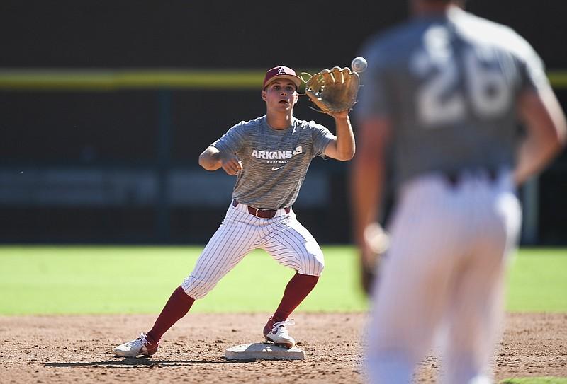 FILE -- Arkansas infielder Robert Moore (1) catches, Thursday, September 23, 2021 during a baseball scrimmage at Baum-Walker Stadium in Fayetteville.  (NWA Democrat-Gazette/Charlie Kaijo)