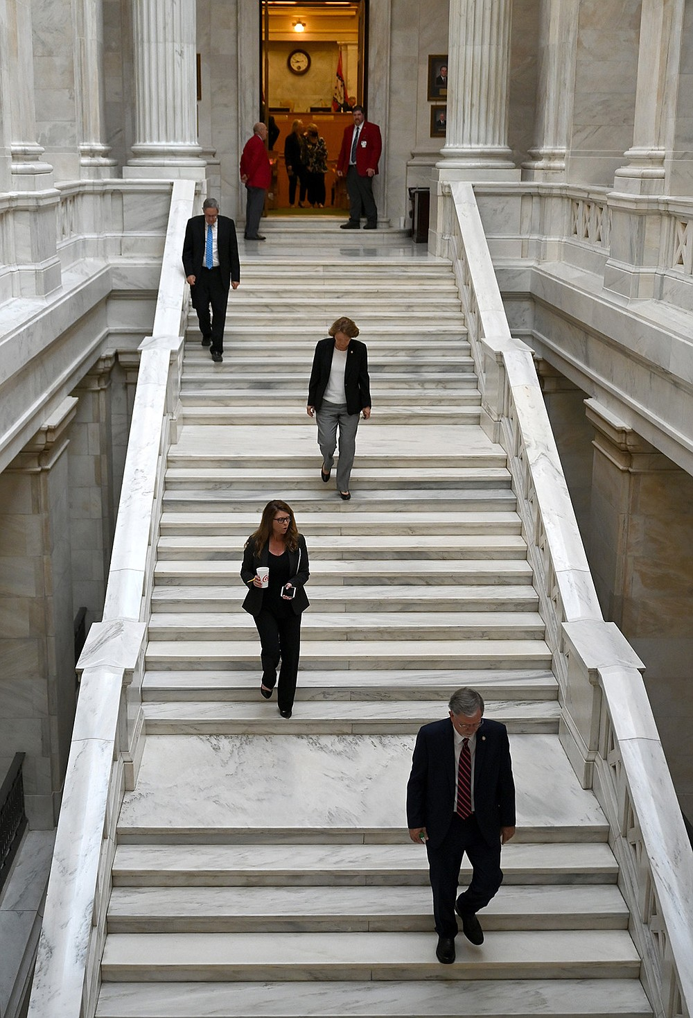 Members of the House Rules Committee head to a meeting Friday to decide if Senate Bill 731 was germane to the extended session. The House finally voted on the bill, rejecting it and ending a week of contentious debate on bills to counter employer-mandated vaccinations. (Arkansas Democrat-Gazette/Stephen Swofford)
