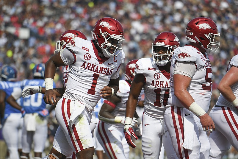 Arkansas quarterback KJ Jefferson (1) carries the ball for a score, Saturday, October 9, 2021 during the first quarter of a football game at Vaught Hemingway Stadium in Oxford, Miss. Check out nwaonline.com/211010Daily/ for today's photo gallery. .(NWA Democrat-Gazette/Charlie Kaijo)