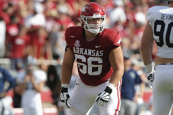 Arkansas offensive lineman Ty Clary (66) prepares for a snap on Saturday, Sept. 18, 2021 during the second quarter of a football game at Reynolds Razorback Stadium in Fayetteville.