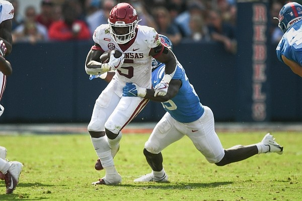 Arkansas running back Raheim Sanders (5) carries the ball on Saturday, Oct. 9, 2021 during the fourth quarter of a football game at Vaught-Hemingway Stadium in Oxford, Miss.