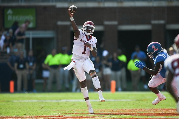Arkansas quarterback KJ Jefferson (1) passes the ball on Saturday, Oct. 9, 2021 during the fourth quarter of a football game at Vaught-Hemingway Stadium in Oxford, Miss.