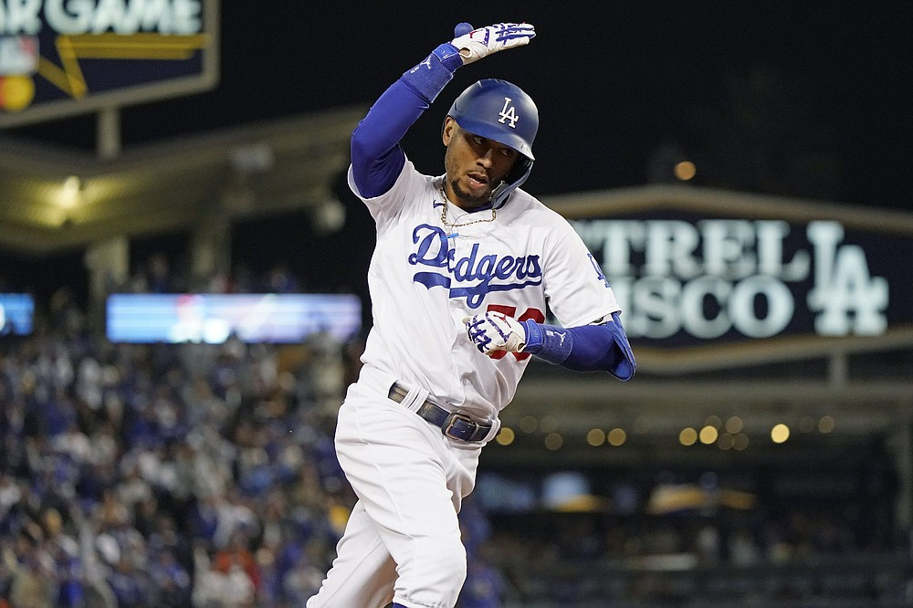 Mookie Betts and the Los Angeles Dodgers have scored nine and seven runs in their two NLDS victories; in their two losses, they've been shut out. (AP/Marcio Jose Sanchez)