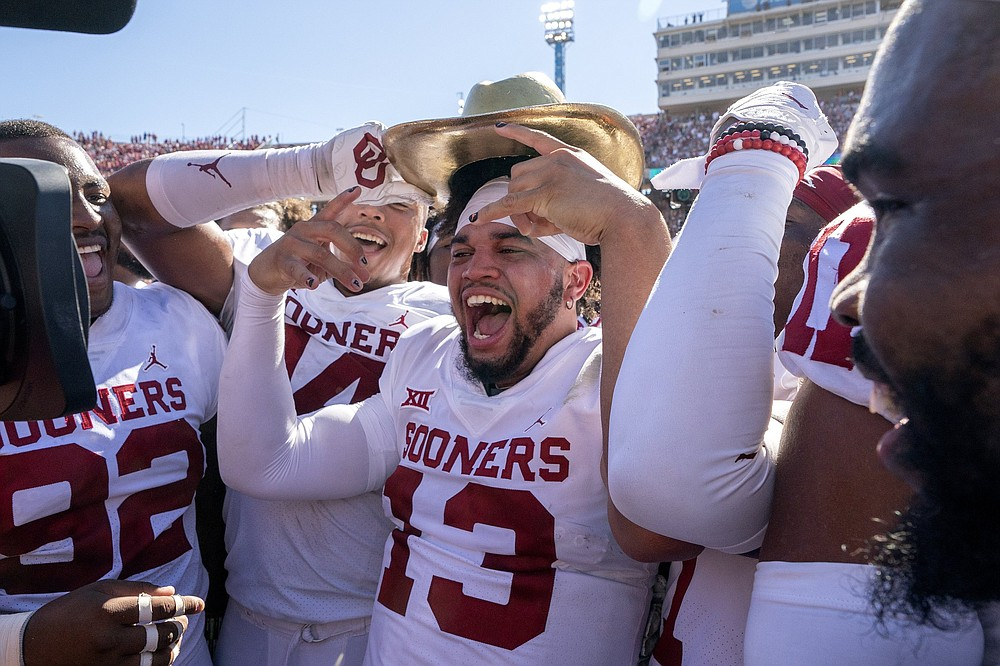 Spencer Rattler has started all six of Oklahoma's games this season, but he was replaced by Caleb Williams (13, shown) on the way to a 55-48 win over Texas last weekend in Dallas. Sooners Coach Lincoln Riley has not named a starter for Saturday's game against TCU. (AP/Jeffrey McWhorter)