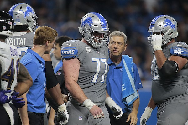 Detroit Lions center Frank Ragnow (77) walks to the sidelines after being injured against the Baltimore Ravens in the second half of an NFL football game in Detroit, Sunday, Sept. 26, 2021. (AP Photo/Tony Ding)