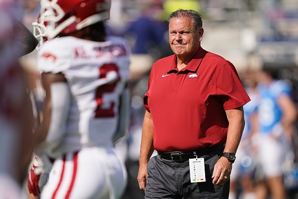 Arkansas head coach Sam Pittman watches his players as they warmup prior to their NCAA college football game against Ole Miss on Saturday, Oct. 9, 2021, in Oxford, Miss. (AP Photo/Rogelio V. Solis)