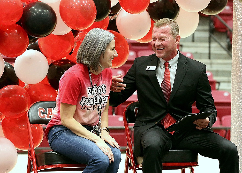 Jessica Saum talks with Cabot Public Schools Superintendent Tony Thurman after Saum was named the 2022 Arkansas Teacher of the Year on Wednesday in Cabot. (Arkansas Democrat-Gazette/Thomas Metthe)