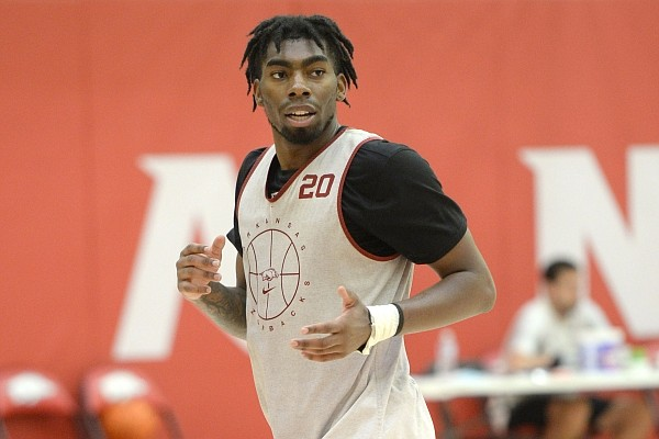 Arkansas forward Kamani Johnson runs to the baseline Tuesday, Sept. 28, 2021, during practice in the university practice facility in Fayetteville.