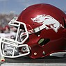 An Arkansas football helmet sits on the sideline during a game against Ole Miss on Saturday, Oct. 9, 2021, in Oxford, Miss.