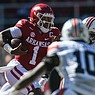 Arkansas quarterback KJ Jefferson carries the ball Saturday, Oct. 16, 2021 during the second quarter of a football game at Reynolds Razorback Stadium in Fayetteville.